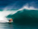 A Surfer Pulls into the Barrel on a Big Day at Uluwatu