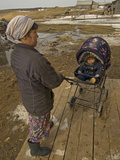 A Nenet Woman and Her Baby Wait Outside a Store in Snopa Village