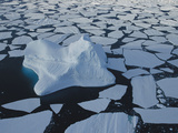 Iceberg Drifting Among Ice Floes  Southern Ocean  East Antarctica