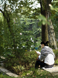 A Young Woman Reads in Jing&#39;An Park
