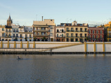 Rower at Sunrise on the Guadalquivir River by the Triana Neighborhood