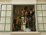 Colonial Shoemaker Works in a Shop with an Open Window