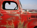 A Close-Up of an Abandoned Red Truck
