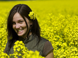 A Young Woman in a Field of Rapeseed  Brassica Napus