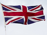 The British Union Jack Flag Flaps Proudly in a Stiff Wind
