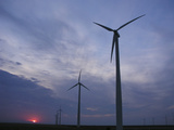 Wind Turbines Silhouetted Against Sunset in Kansas