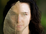 A Model Holds Up a Transparent Leaf
