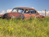 A 1950 Chevrolet Styleline Deluxe 4-Door Sedan Sits Idle in a Field