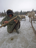 A Nomadic Komi Reindeer Herder Fishes in a Hole with Primitive Gear