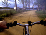 Point of View Photograph of a Road over the Handlebars of a Bike