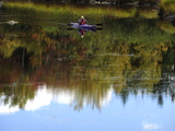 A Kayaker Looks Through Binoculars