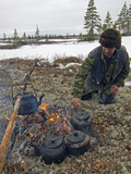 A Komi Reindeer Herder Makes Tea During Reindeer Calving Season