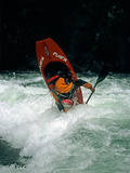 A Kayaker Paddles in Waves on the Kananskis River  Near Calgary
