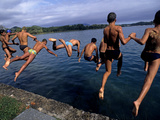 Men Jumping into Lake Banyoles