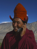 The Head Abbot Talks on a Cell Phone at the Karsha Monastery