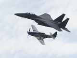 An F-15 Eagle and the P-51 Mustang Fly in Formation