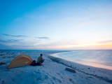 A Solo Camper Watches the Sunset from a Tiny Island Far Out to Sea