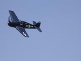 A Blue Grumman F6F-5 Hellcat Fighter Aircraft Flies Solo