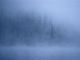 Morning Mist Rises Off a Lake in Algonquin Park in Central Ontario