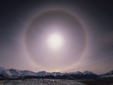Sun Halo over Southern Alps  Caused by Ice Crystals in the Air  Castle Hill  New Zealand