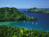 Sailboats Anchored in a Cove of Blue Water on Nuku Hiva Island