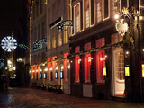 A Street Scene at Night During the Christmas Season