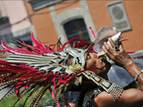 A Conchero Aztec Dancer Elebrates Toxcatl  Dedicated to the Sun