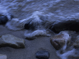 A Wave Rushes over Pebbles on the Shore of Lake Michigan