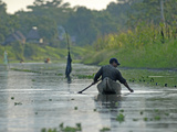 A Yanayacu Indian Fisherman Floats His Canoe in the Yanayacu River