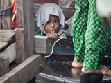 Portrait of a Child on a Boat at Tonle Sap  Cambodia