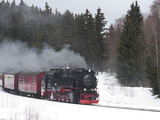 Meter-Gauge 2-10-2T Steam Locomotive 99 7241-5 in a Snowy Landscape