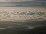 Mount Kilimanjaro  Surrounded by Clouds  Seen from the Air