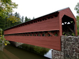 Covered Bridge over a Calm Stream