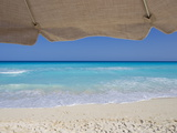 View of Turquoise Waters from Underneath a Beach Umbrella