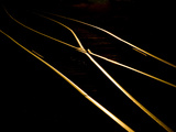 Golden Evening Sunlight Reflects Off Railroad Tracks