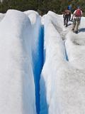 Hikers Exploring Perito Moreno Glacier Pass a Deep Crevass