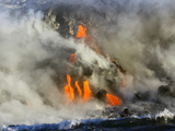Glowing Lava and Rising Steam at the Edge of the Sea