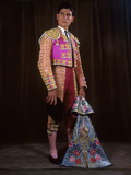 A Matador Poses in Full Regalia with an Embroidered Cape