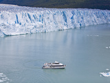 Tourist in a Boat Close to Perito Moreno Glacier Hope to Witness Calving
