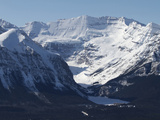 The Snow-Dusted Canadian Rocky Mountains and Lake Louise Below