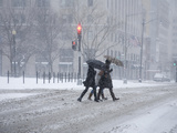 A Trio of Pedestrians Rush Through the 'Blizzard of 2010'