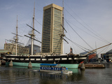 A Water Taxi Passes US Constellation in Baltimore's Inner Harbor