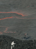 A Volcanologist  Wearing a Thermal Suit  Approaches an Active Lava Lake