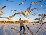 A Woman Spreads Her Arms as a Flock of Birds Fly Overhead
