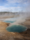 Steam Rising from Turquoise-Hued Water in a Geothermal Colloidal Pool