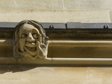 Sandstone Sculpture of a Funny Face  on the Wall of a Building