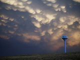 Cloud Formations Above a Water Tower on the Edge of Pine Ridge
