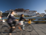Bicyclists and Traffic in Front of the Potala Palace