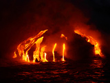 Glowing Hot Lava Flowing into the Sea at Night