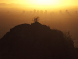 Silhouetted View of Phoenix  Arizona and a Hill at Sunset